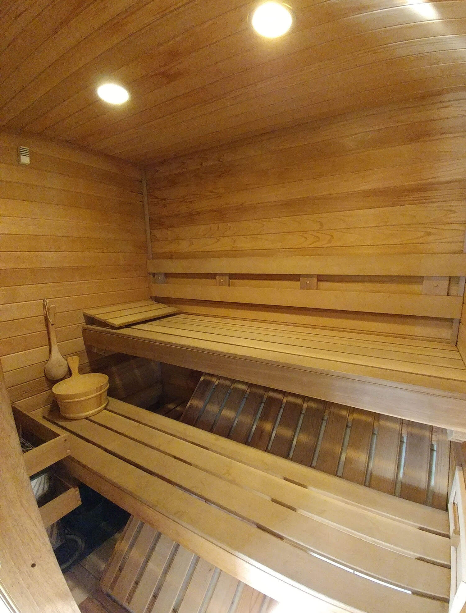 A large sauna with wooden walls and benches.