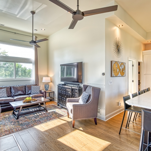 The Addition Living room has soaring ceilings and fills with natural light, open to kitchen and has pullout queen sofa bed, Smart TV, wood burning stove